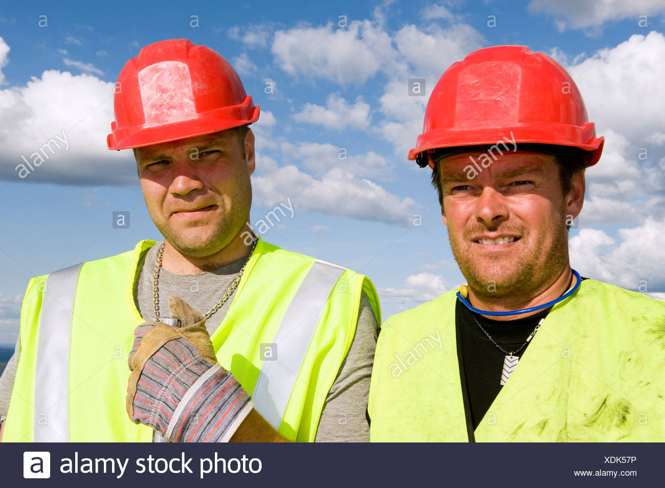 Construction workers smiling at camera - Stock Image