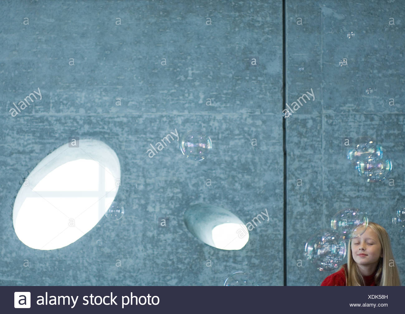 Girl dreaming, surrounded by bubbles Stock Photo