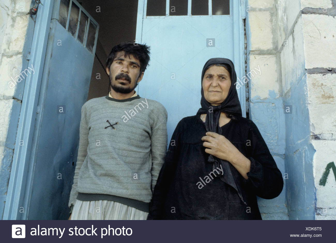 Kurdish woman with her son, who became psychologically ill as a result of war. Suleymaniya, Iraq. 1992 - Stock Image