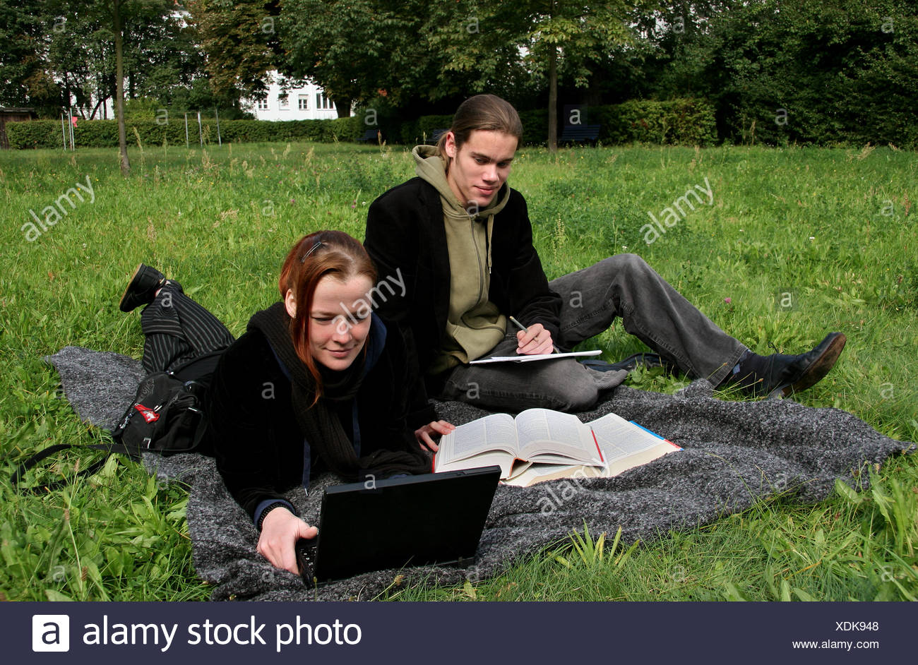 students learn in the park - Stock Image