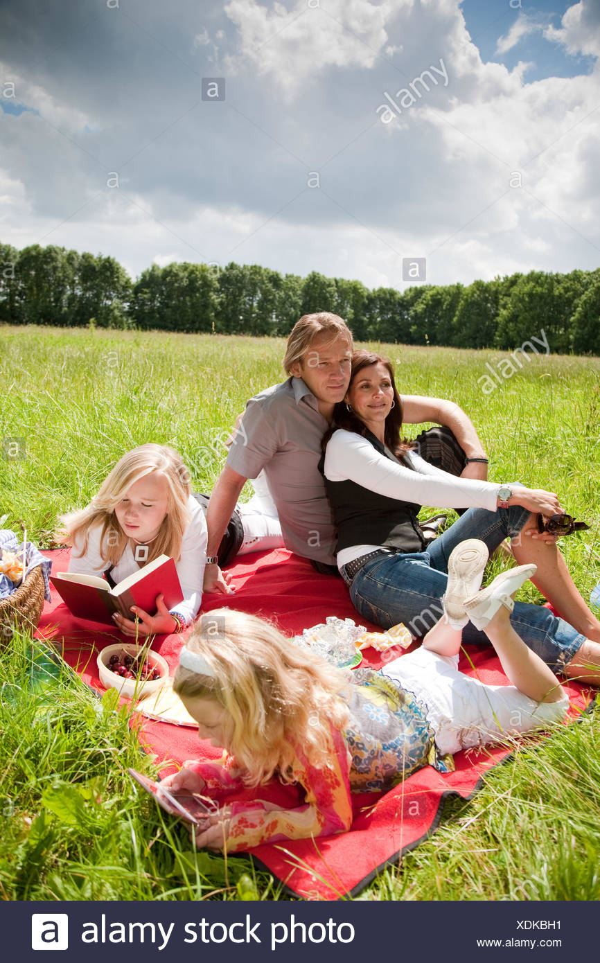 Lovely family enjoying the outdoors - Stock Image
