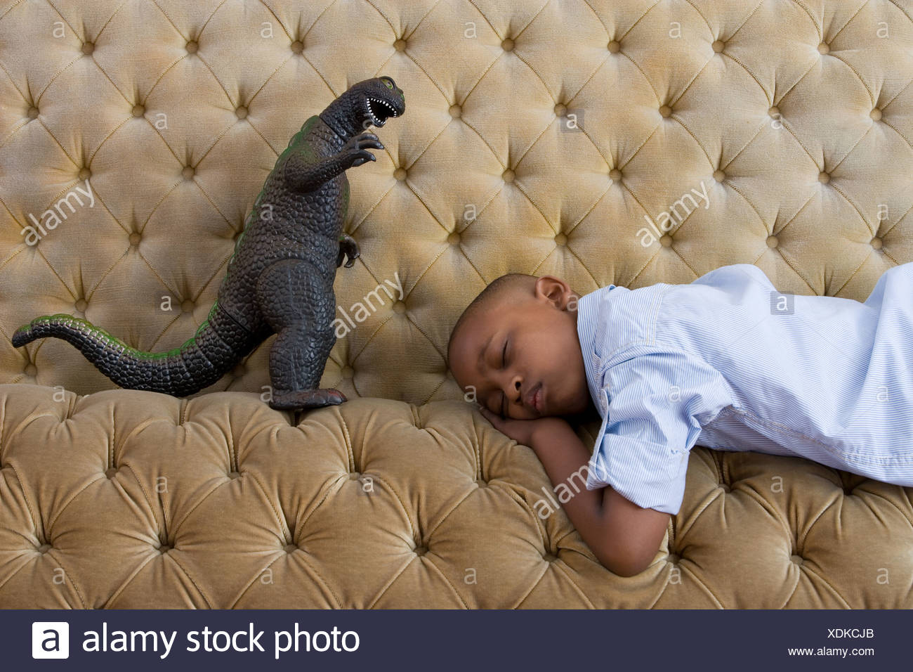 Toy monster and boy sleeping - Stock Image