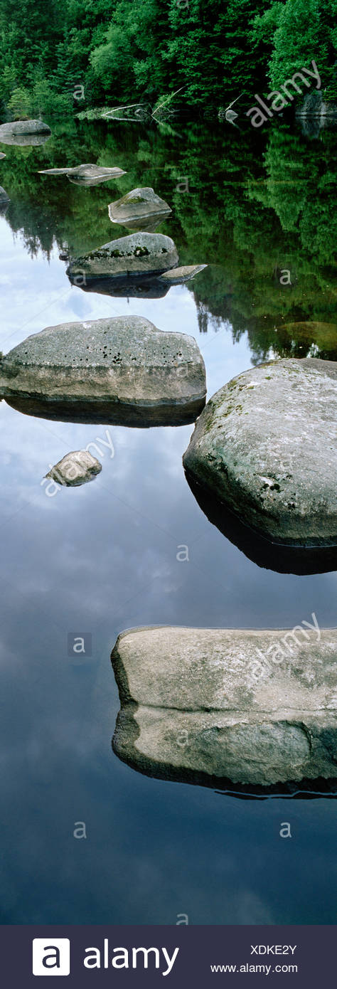 rocks and boulders in a lake, Val David, Quebec, Canada. - Stock Image