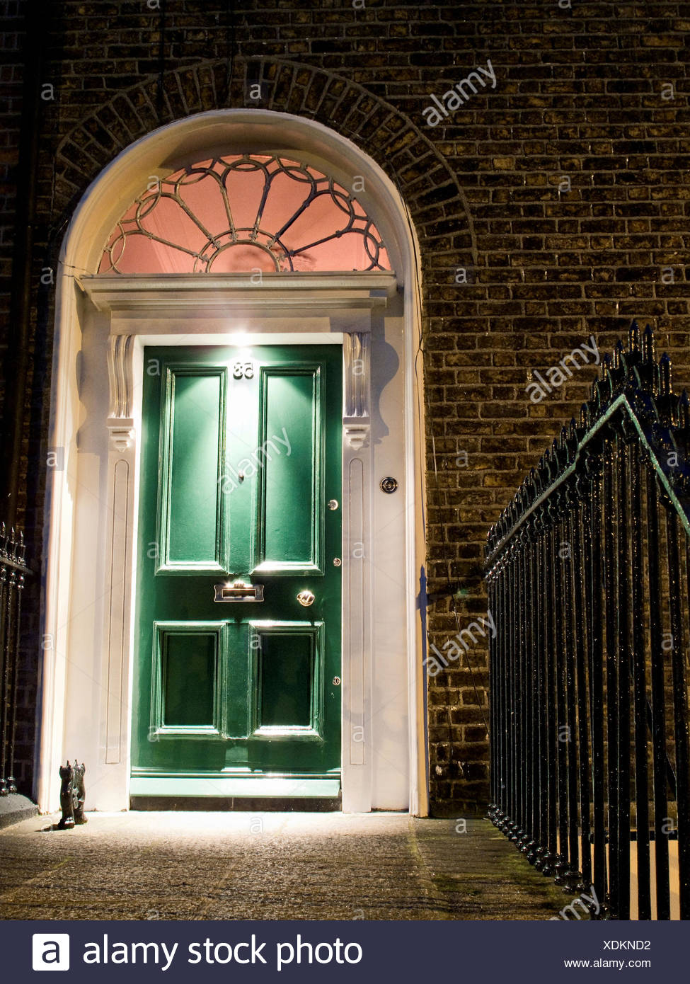 Typical Irish door in the night, Dublin, Ireland - Stock Image