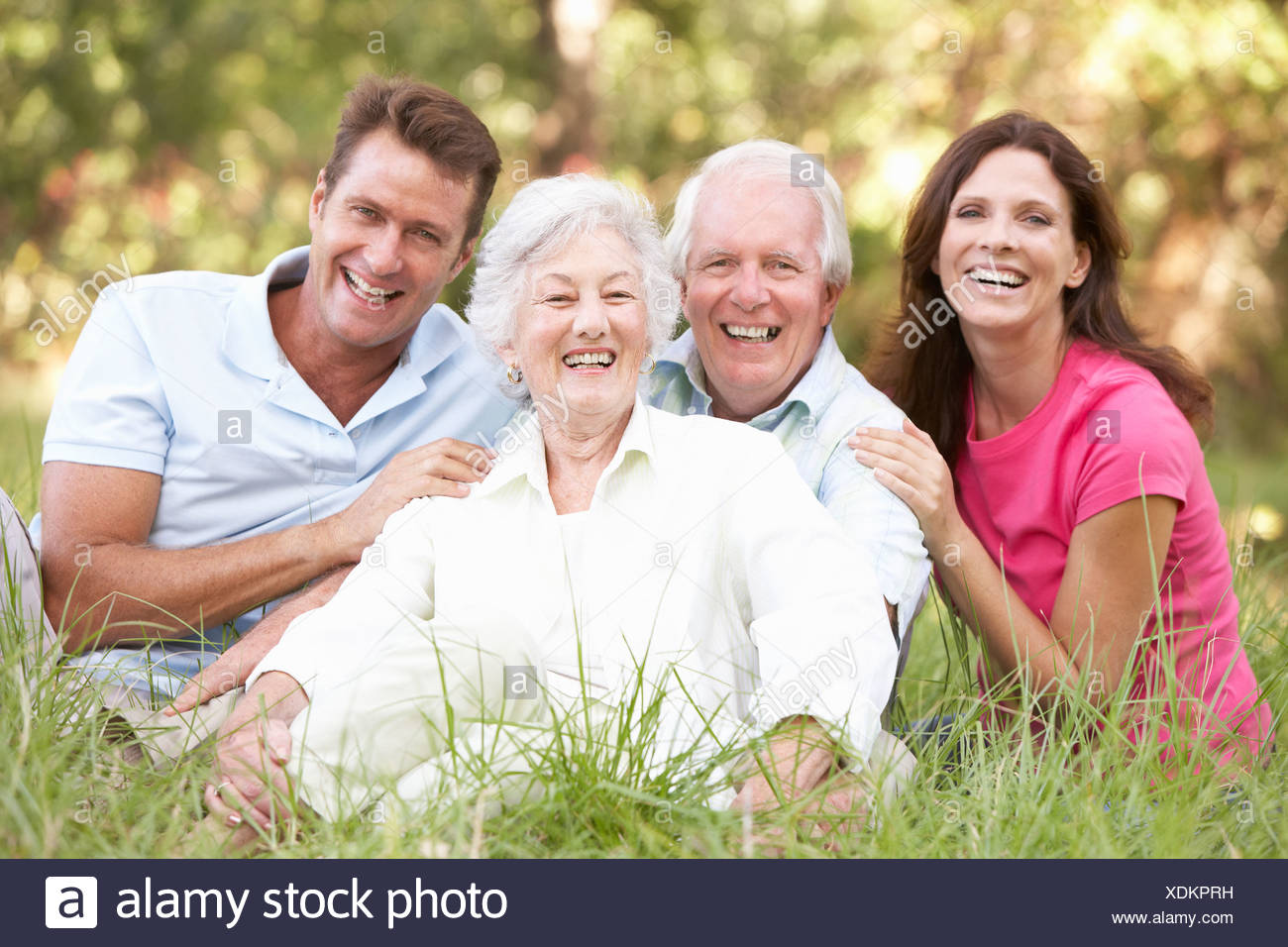 Senior Couple With Grown Up Children In Park - Stock Image
