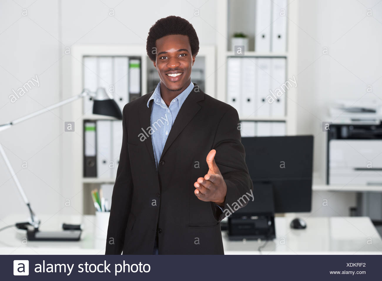Businessman Offering Handshake - Stock Image