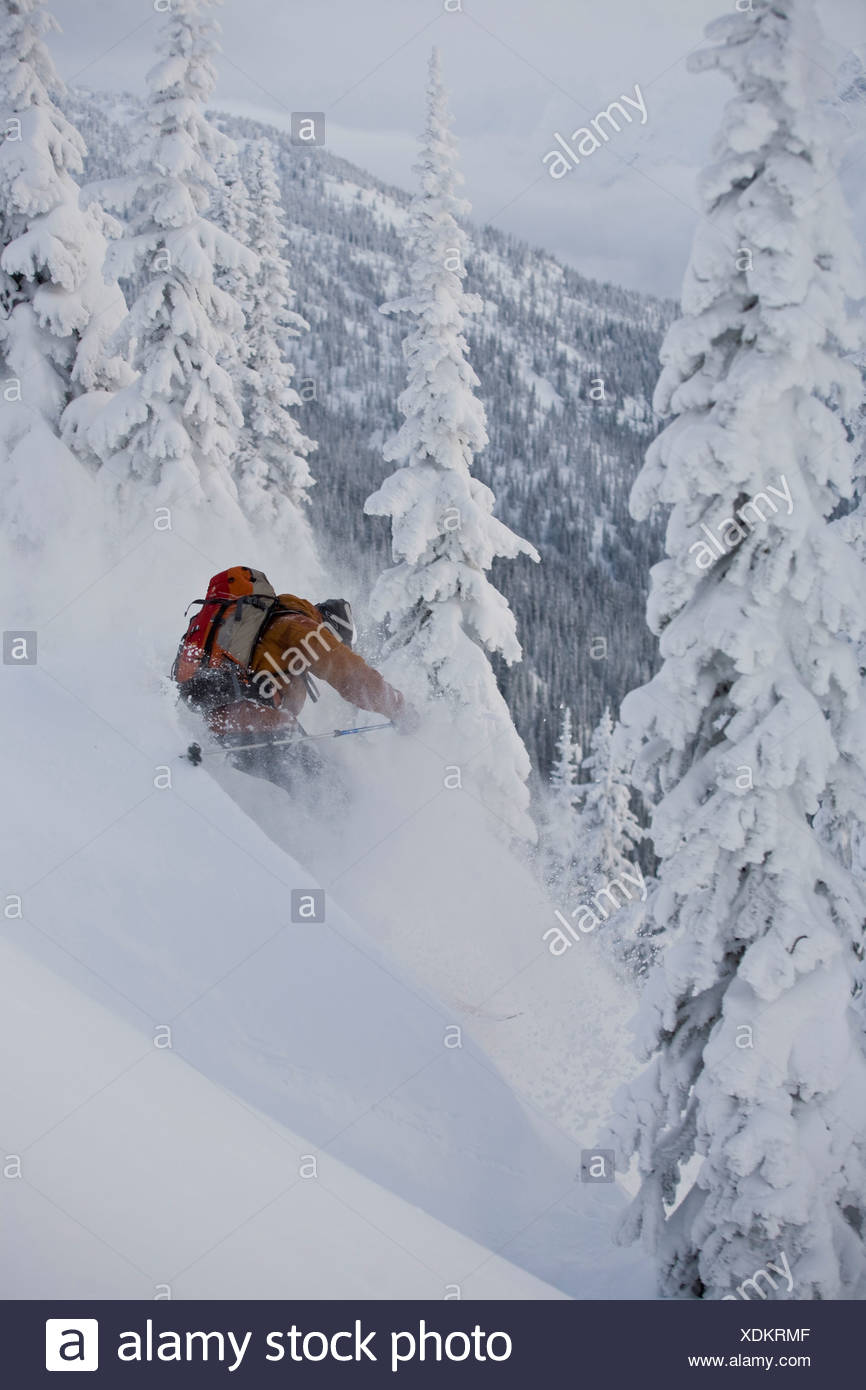 A young man making deep turns in Roger's Pass, Glacier National Park, BC - Stock Image