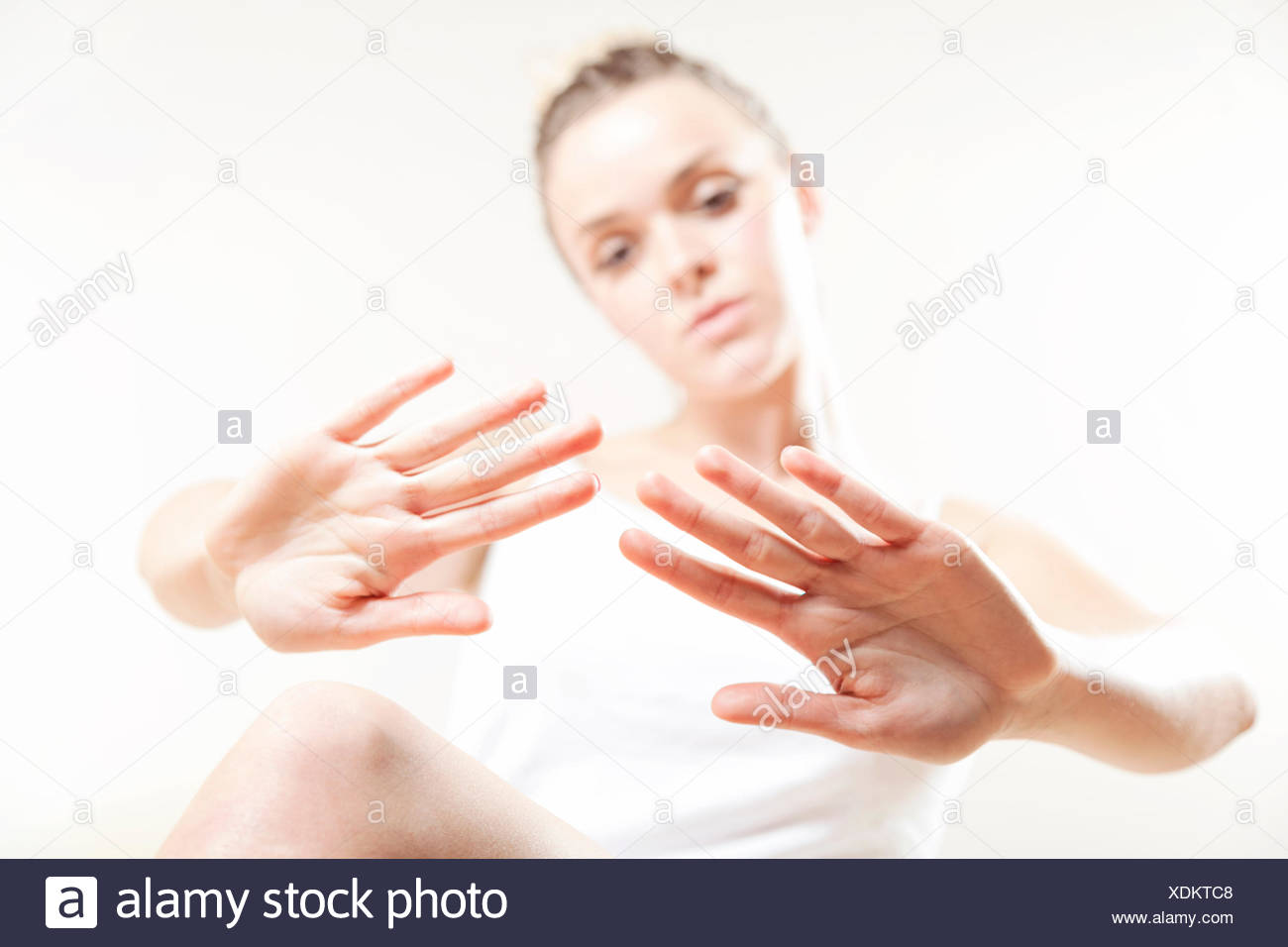 Young woman examining her fingernails - Stock Image