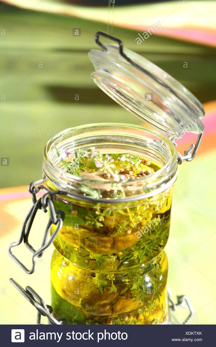 Jars of ceps preserved in olive oil - Stock Image