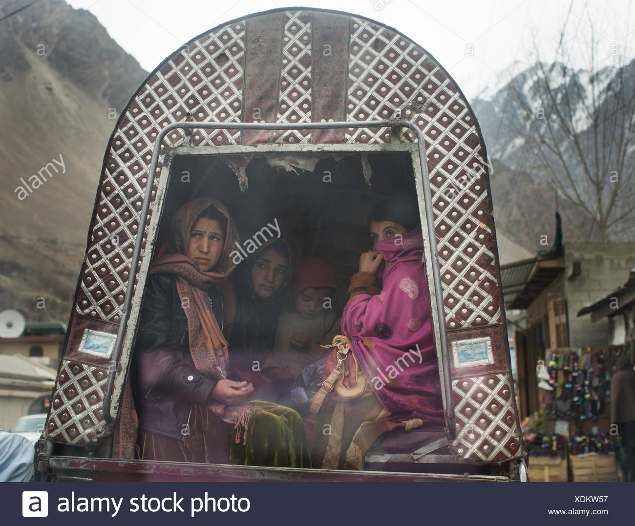 Women in a public minibus in the Hunza Region. - Stock Image