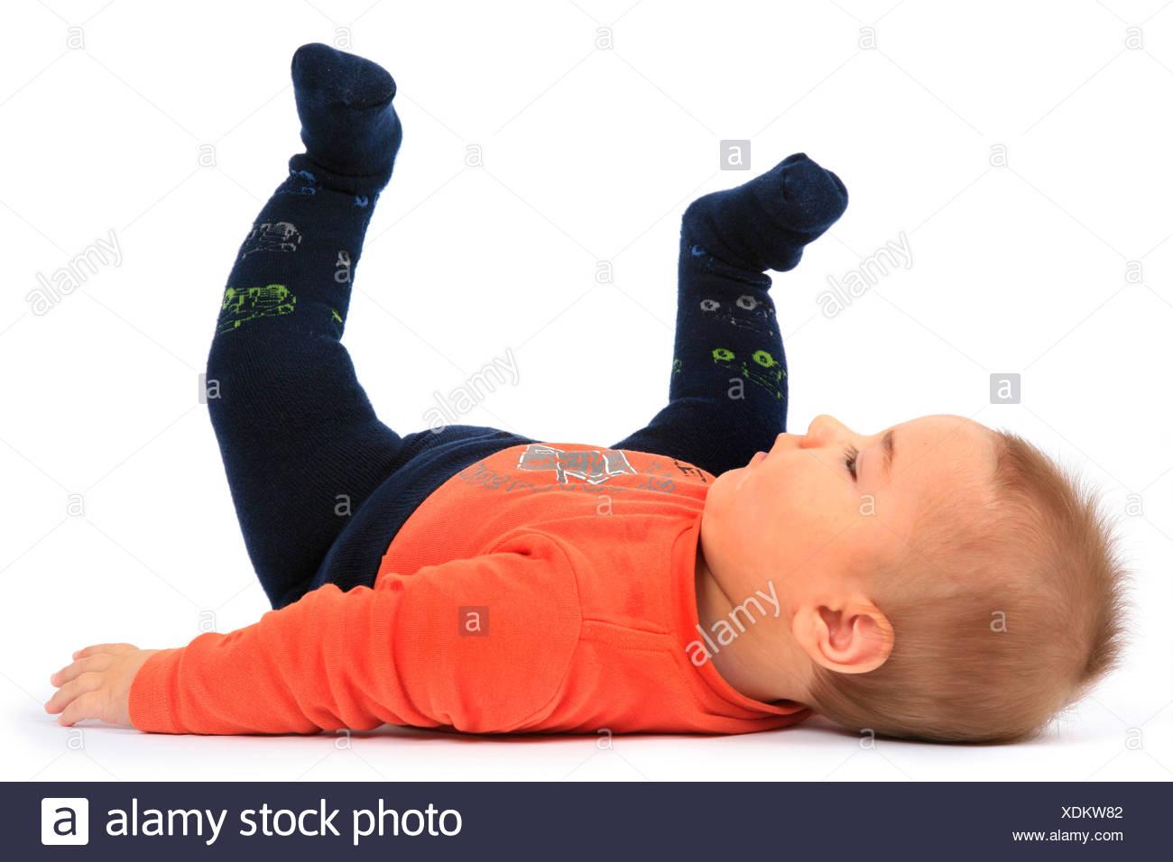 lying baby - Stock Image