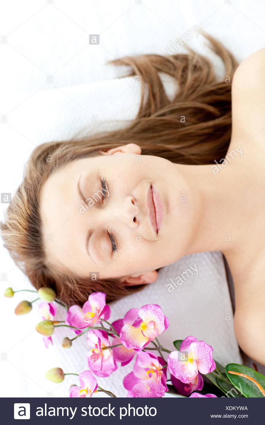 Laid-back woman having a massage - Stock Image