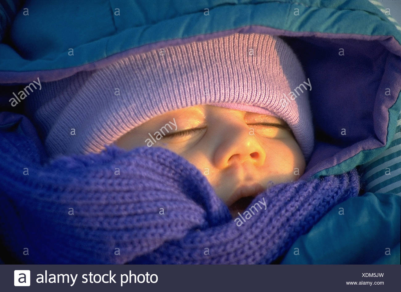 baby is sleeping deeply,evening sun,winter - Stock Image
