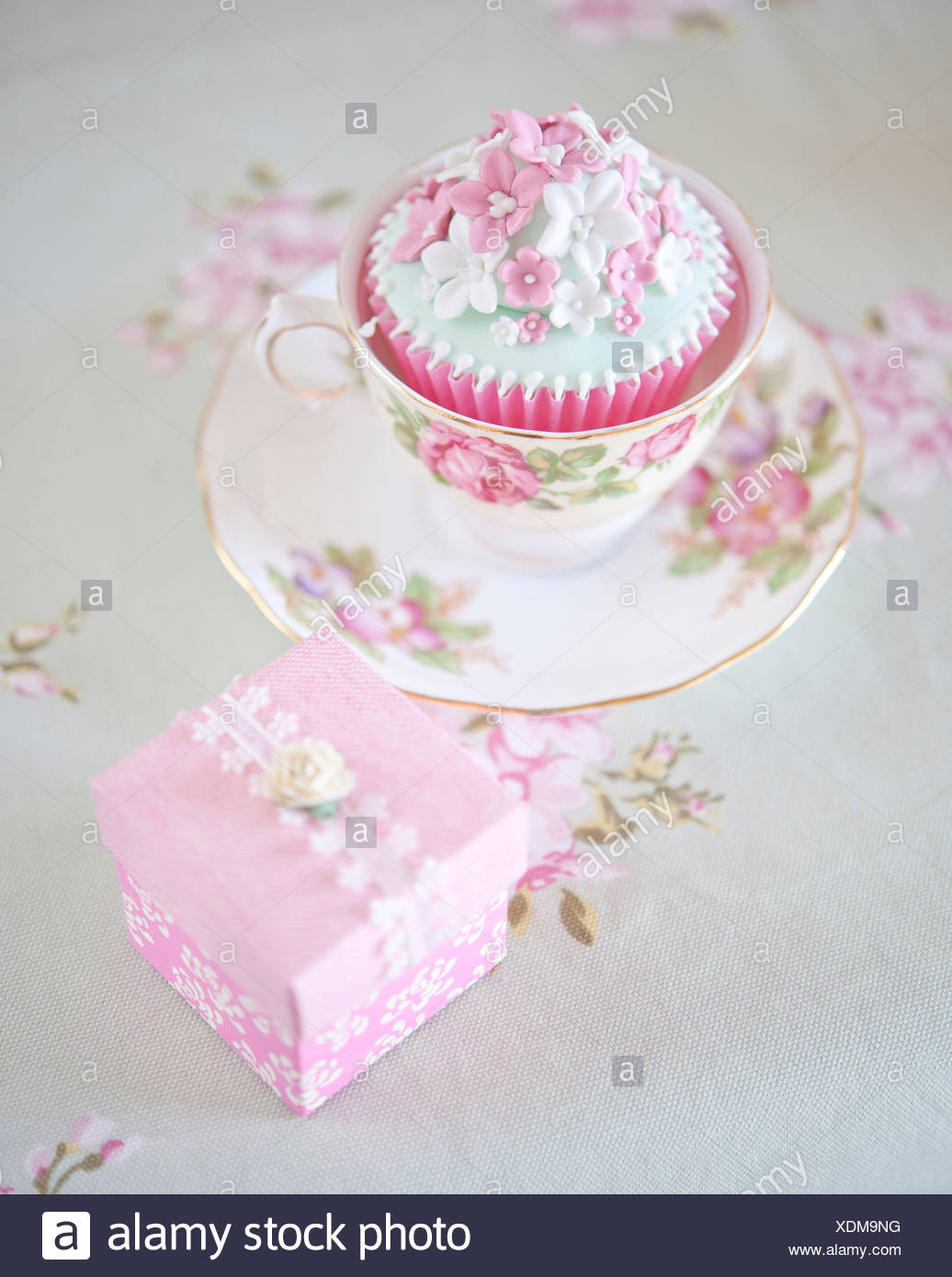 A Floral China Cup Saucer And Plate With Iced Cupcake And Cake Box Stock Photo Alamy