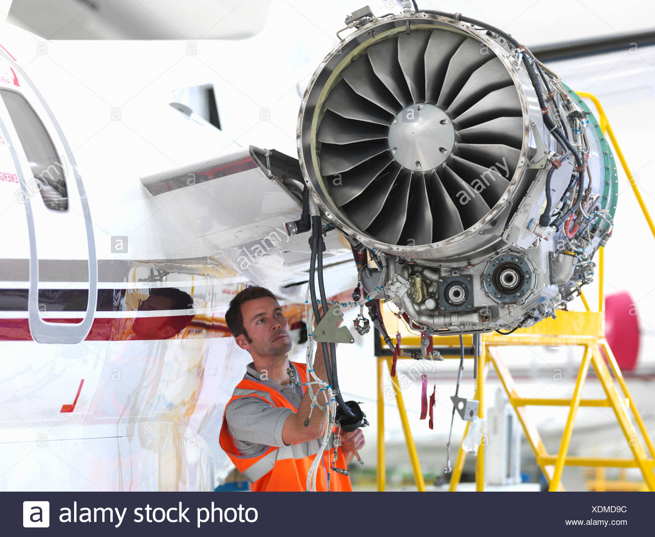 engineer inspects jet engine stock image