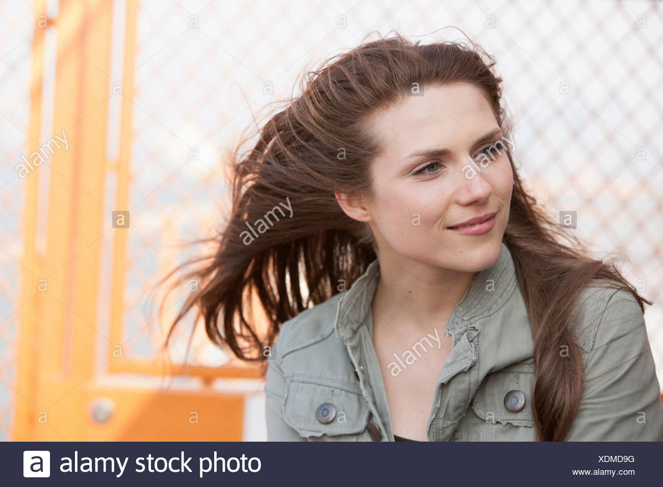 Portrait of a young woman outdoors - Stock Image