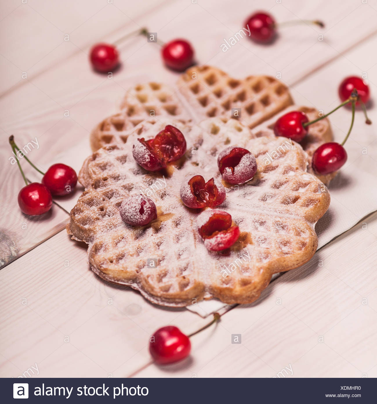 Waffles with cherry on white wooden plank. Debica, Poland - Stock Image
