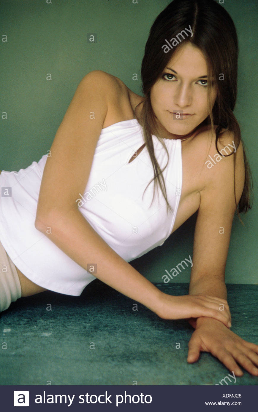 Young woman wearing white top - Stock Image