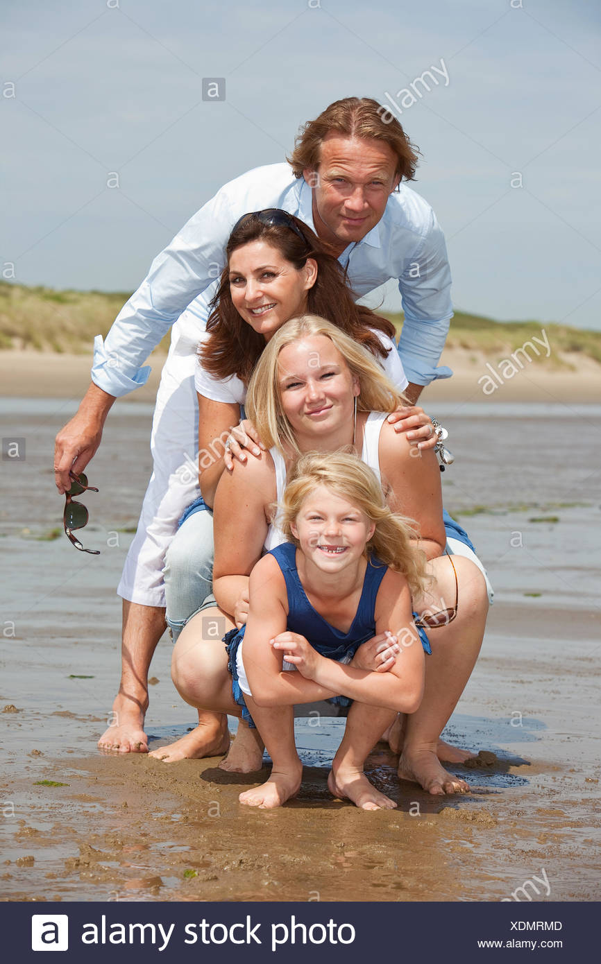 Young family by the seaside - Stock Image