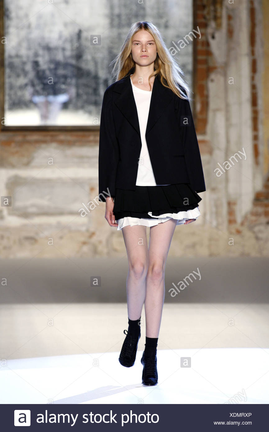 63ebcf04f34 Anna Molinari Milan Ready to Wear Spring Summer Black jacket over white top  and ra ra skirt with ankle socks and shoe boots