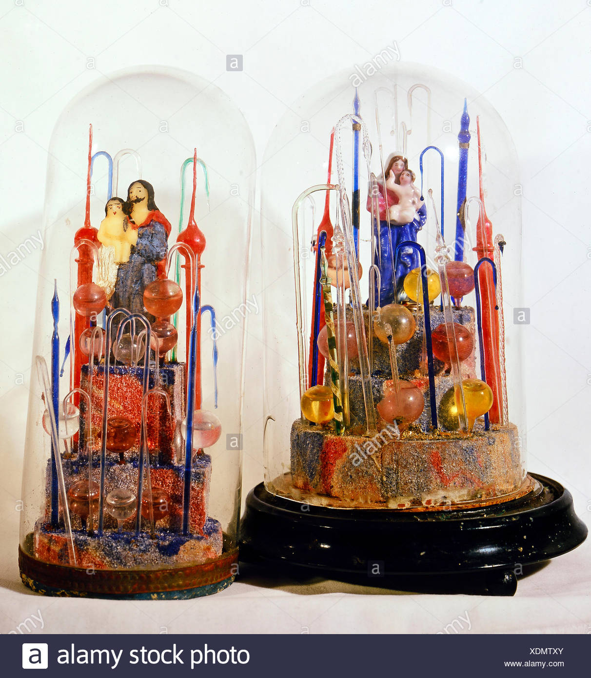fine arts, folk art, devotional thing, Madonna and Saint Joseph with child under glass covers, glass, wax, Bavaria / Bohemia, early 19th century, Berchtesgaden, Rupert Stoeckl collection, Munich, Artist's Copyright has not to be cleared - Stock Image