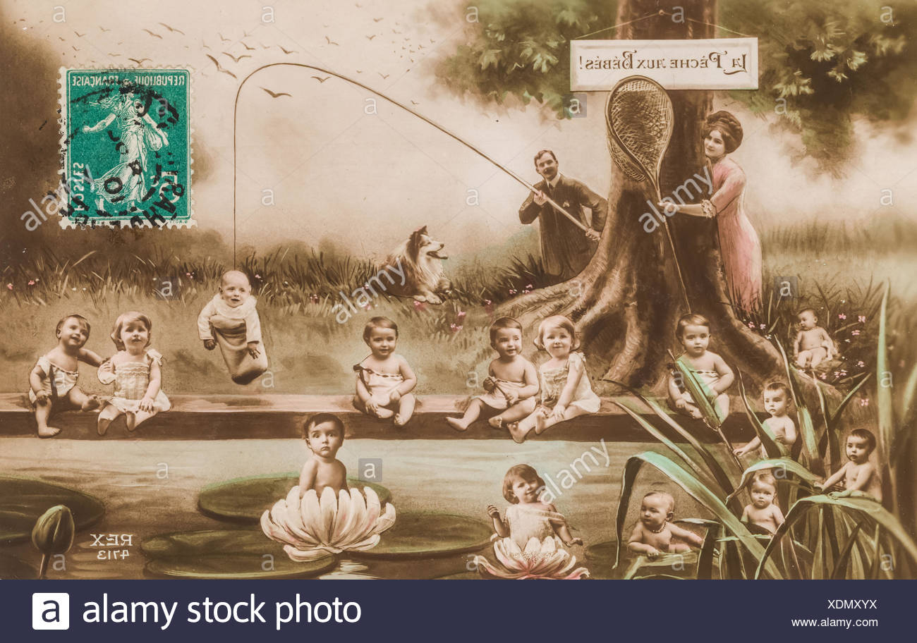 Babies fishing, funny old postcard depicting a young couple fishing a baby in a pond. - Stock Image