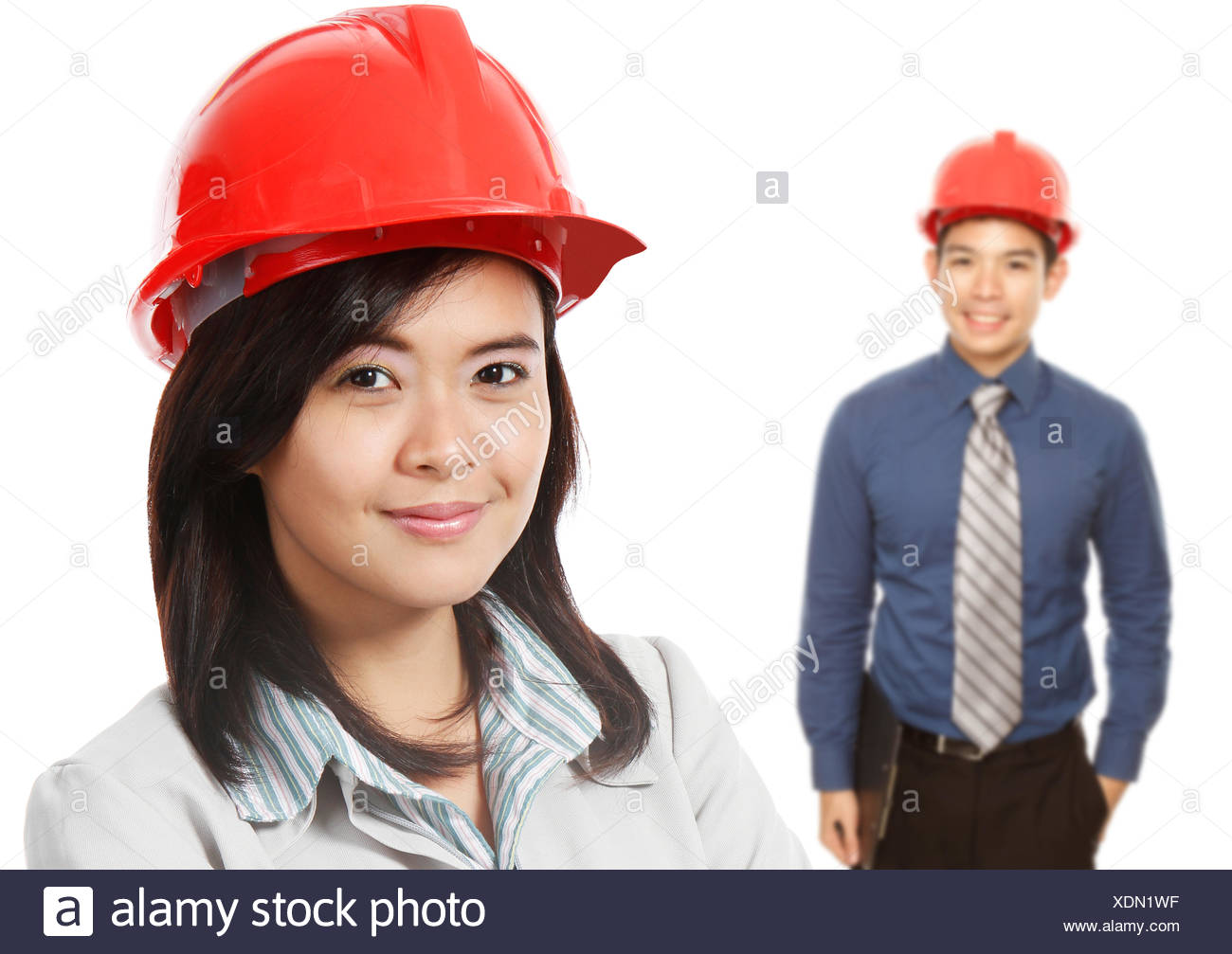 Man and Woman With Hardhats - Stock Image