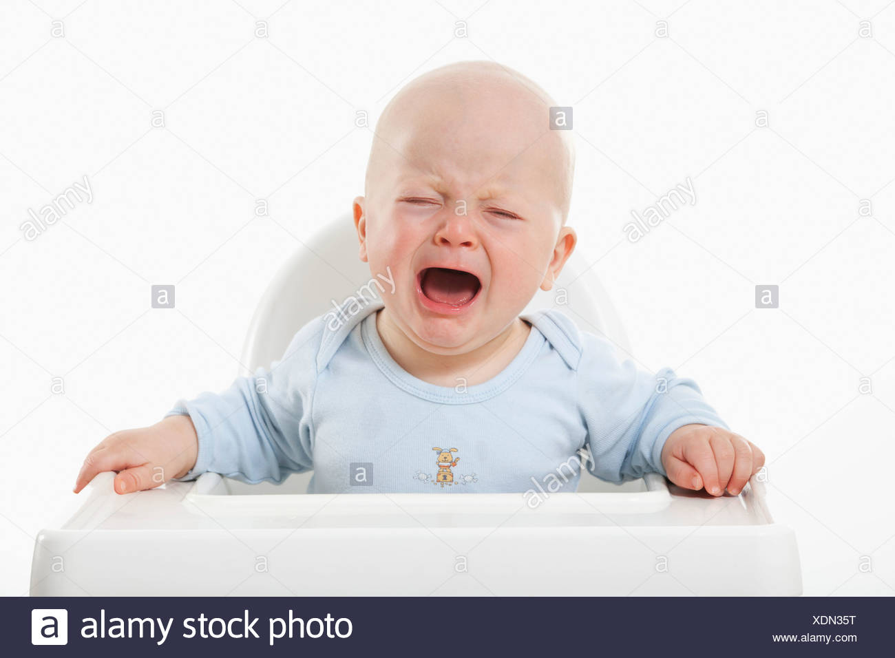 Baby boy (6- 11 Months) crying Stock Photo
