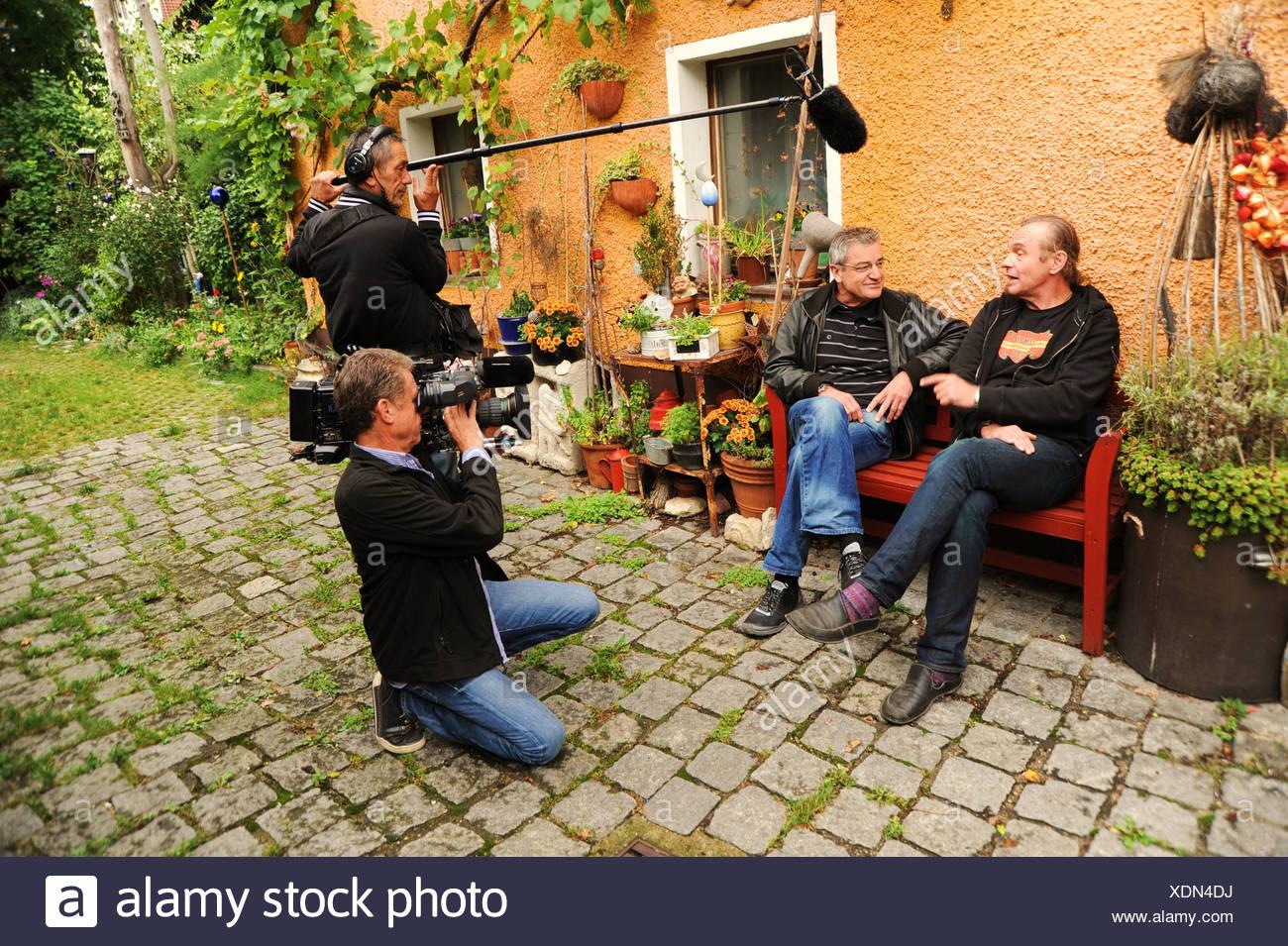 Franz Xaver Gernstl, 2nd left, director of TV series Gernstl Unterwegs, interviewing the art restorer Stephan Muehlbauer, left, Stock Photo