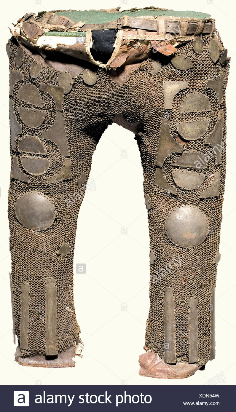 Armoured trousers, Persian, 19th century Ankle-length, linen-lined, leather trousers completely covered with iron chain mail of unriveted rings. The front is richly set with small iron plates bearing brass floral inlays. Inlays somewhat worn. The mail is badly defective at the waist and crotch. Leather damaged in places. Length ca. 80 cm. historic, historical, 19th century, Persian Empire, object, objects, stills, clipping, clippings, cut out, cut-out, cut-outs, fine arts, art, artful, Additional-Rights-Clearances-NA - Stock Image