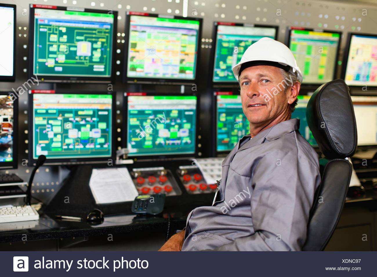 Man working in security control room - Stock Image
