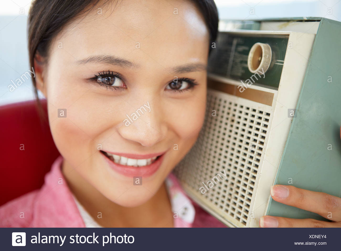 Young woman listening to radio Stock Photo