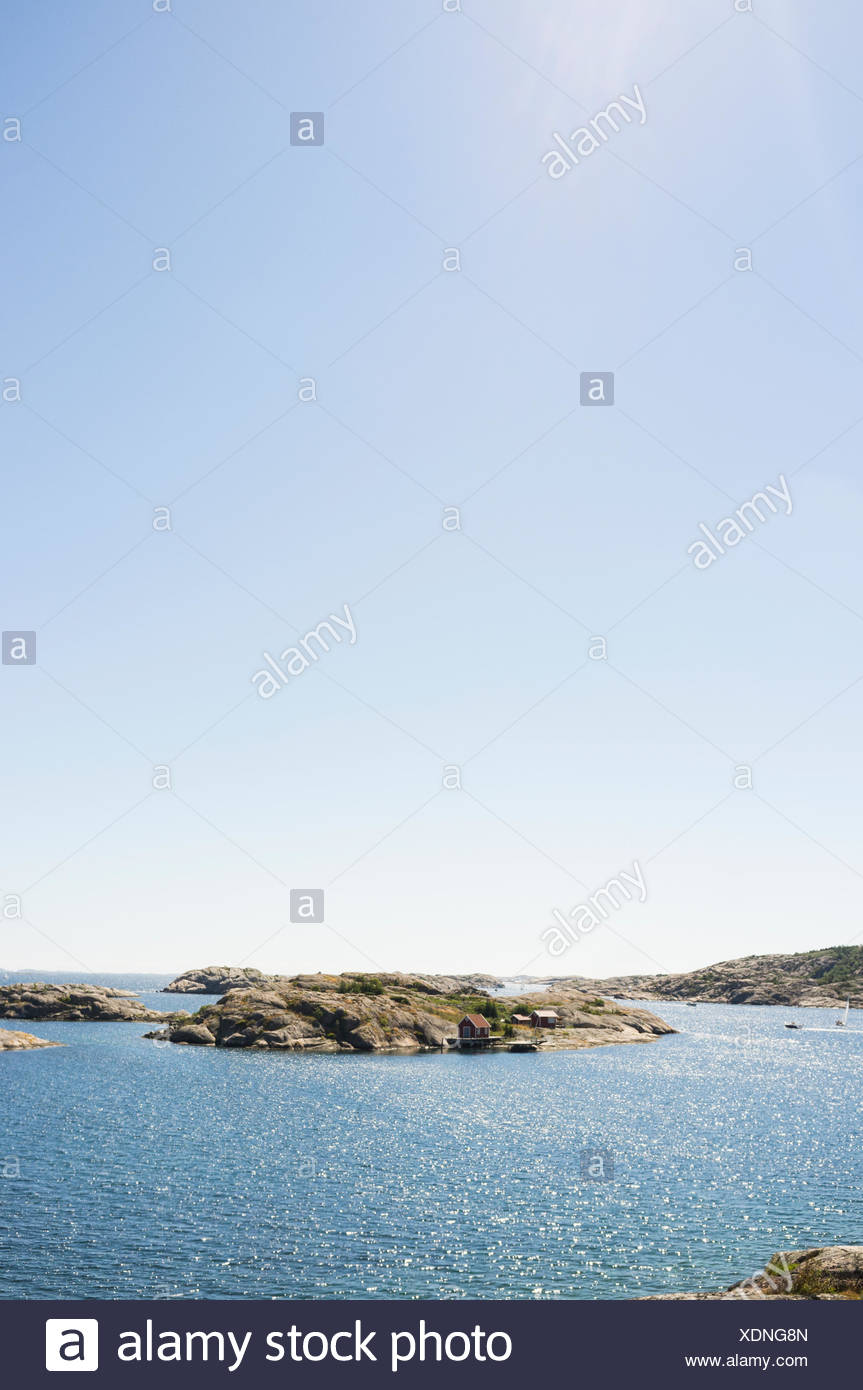 Idyllic view of lake against clear sky - Stock Photo