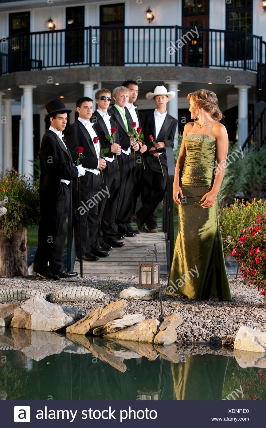 Woman In A Formal Dress; Woman Making A Choice In Men Stock Photo