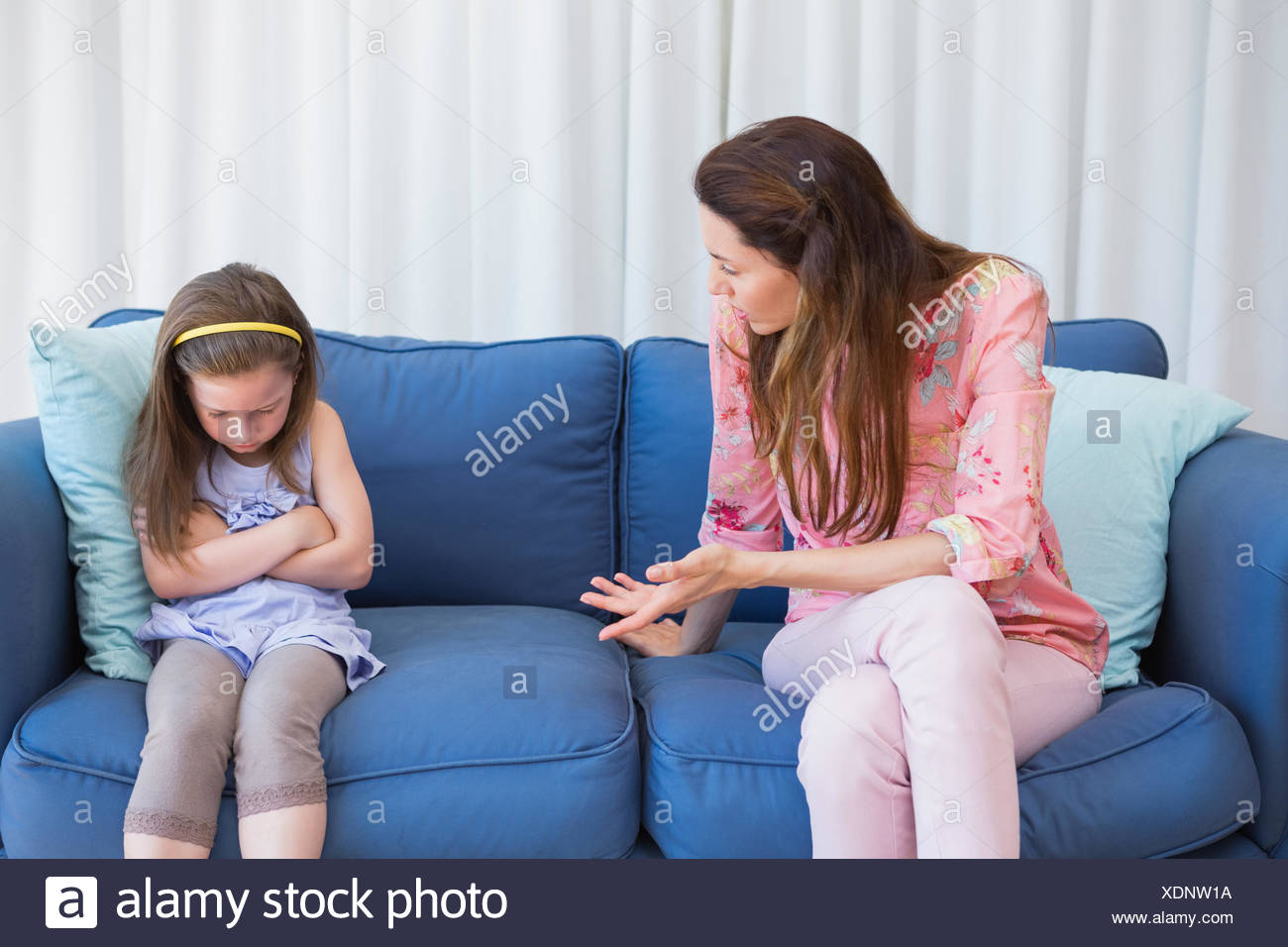 Mother scolding her naughty daughter Stock Photo
