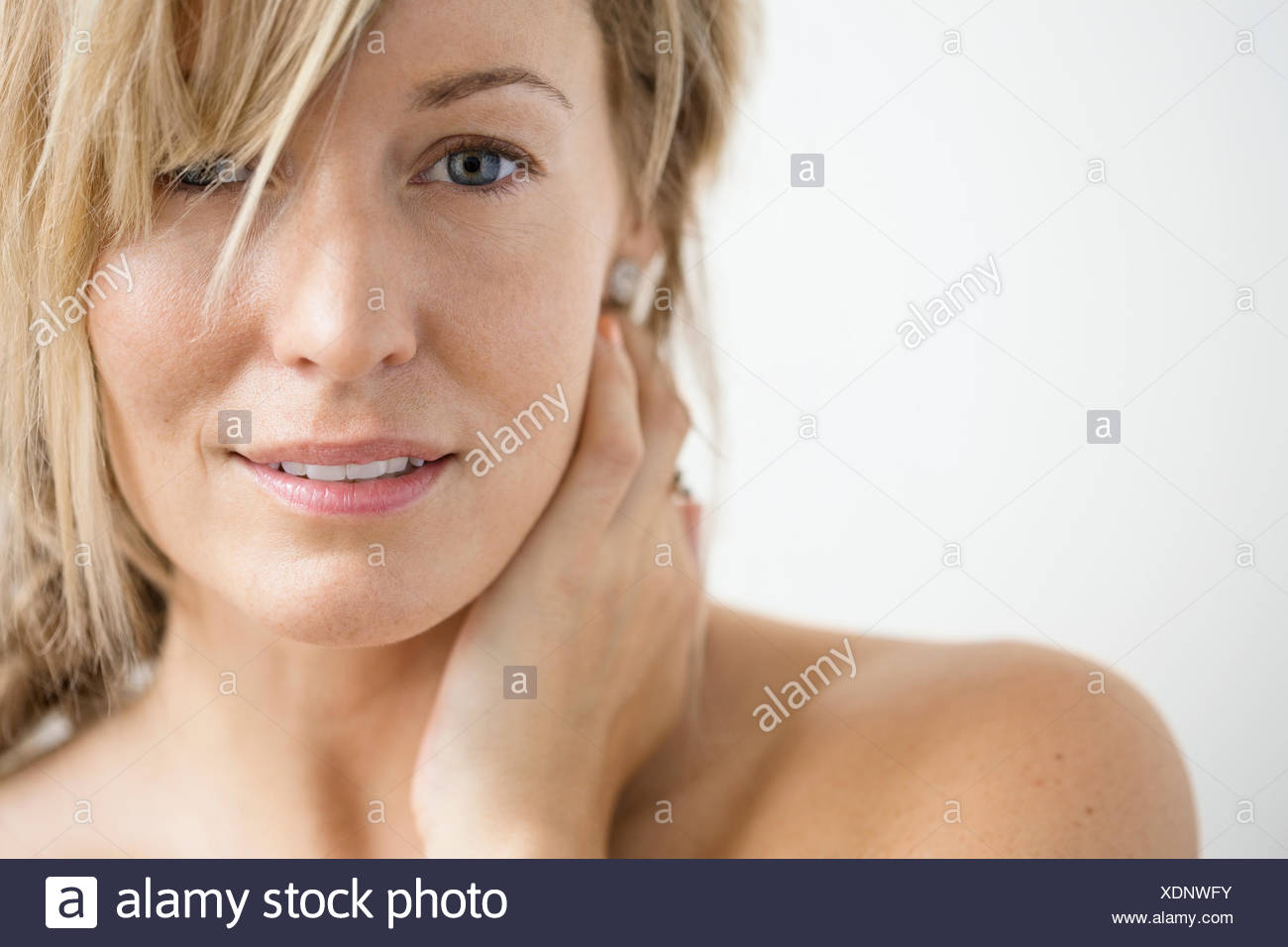 Close up of blonde woman with bare chest - Stock Image