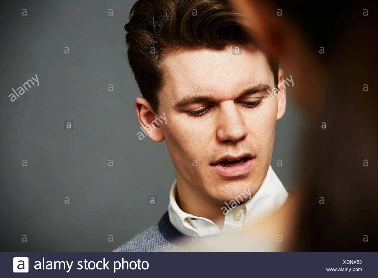 Candid portrait of young man close up - Stock Image