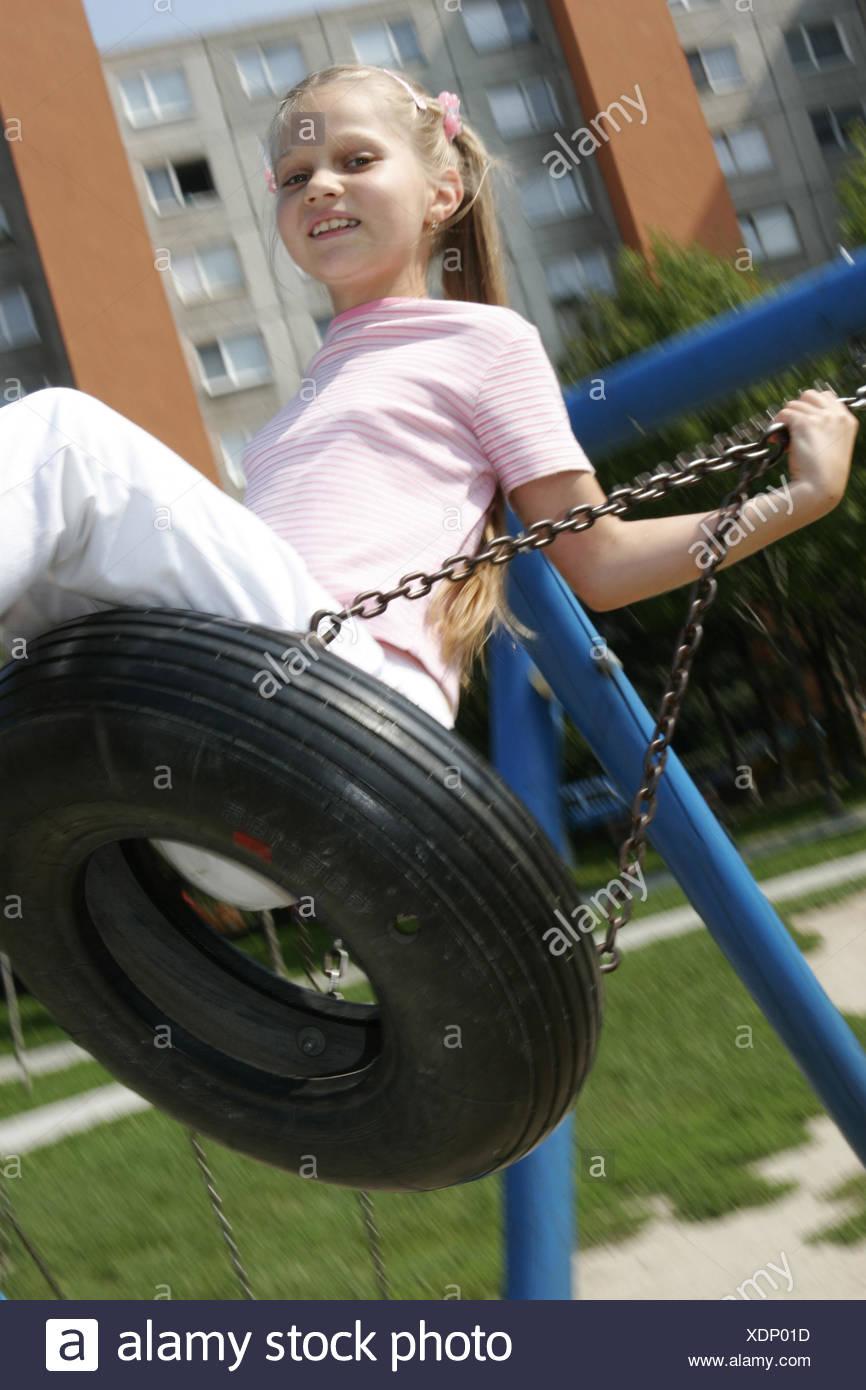 Lifestyle, Aussen, Bewegung, Freizeit, Freude, Gefuehl, Gesichtsausdruck, Gluecklich, Kind, Kinder, Maedchen, Menschen, Park, Pa - Stock Image