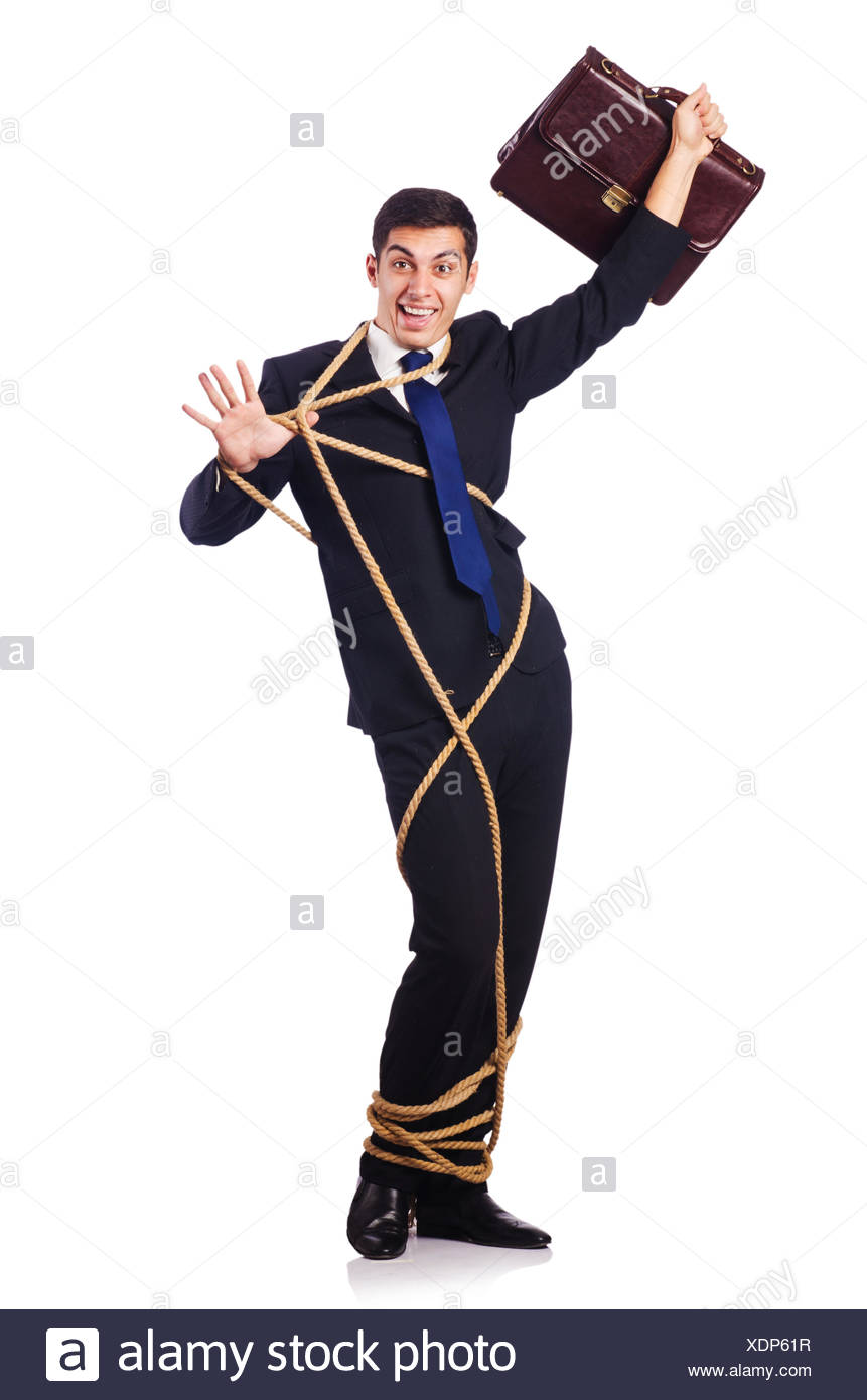 Businessman tied up with rope on white - Stock Image