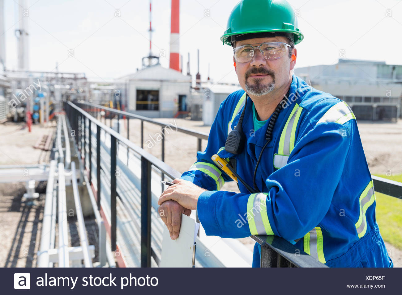 Portrait of worker on platform outside gas plant Stock Photo