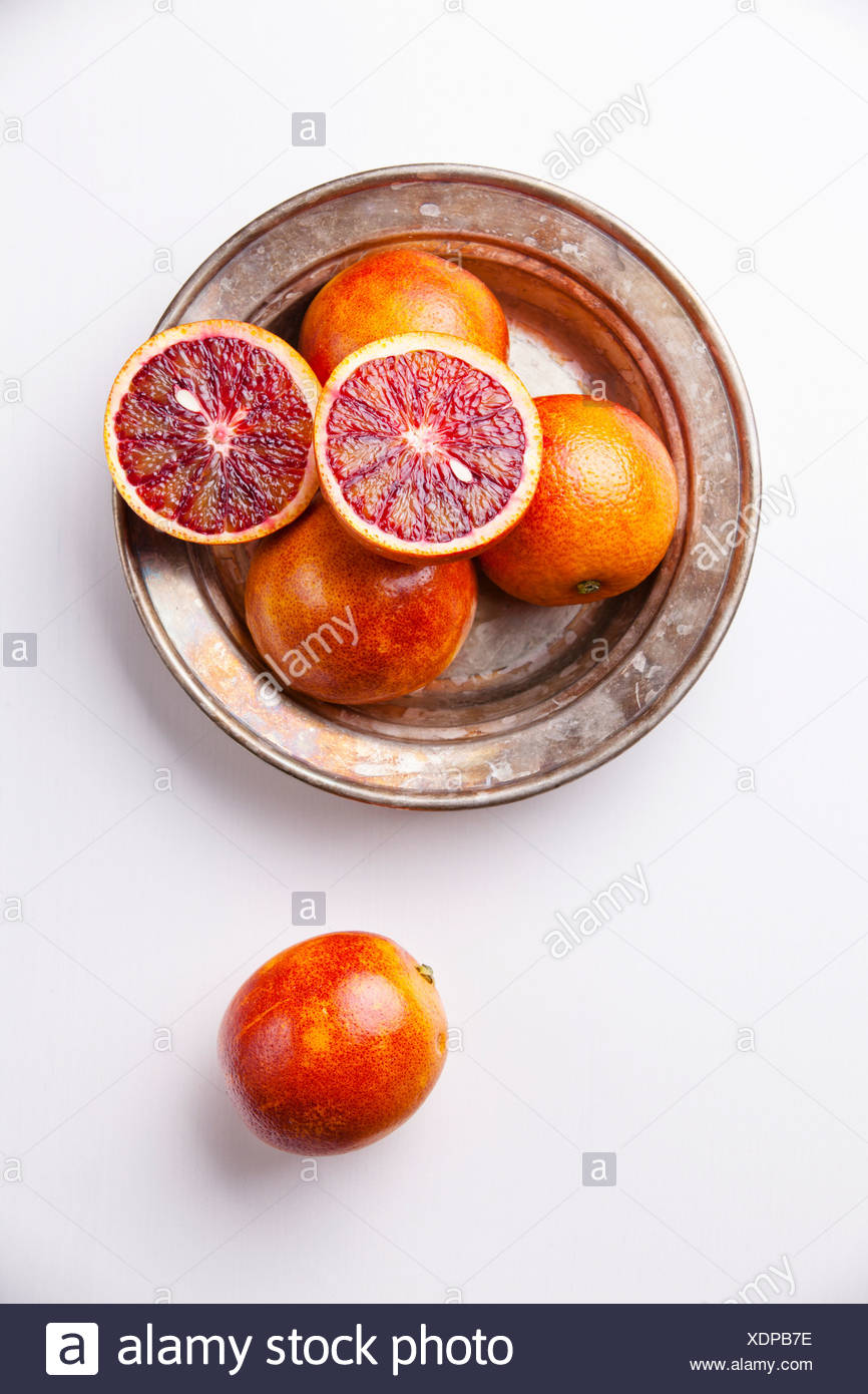 Ripe red oranges on white textured background Stock Photo