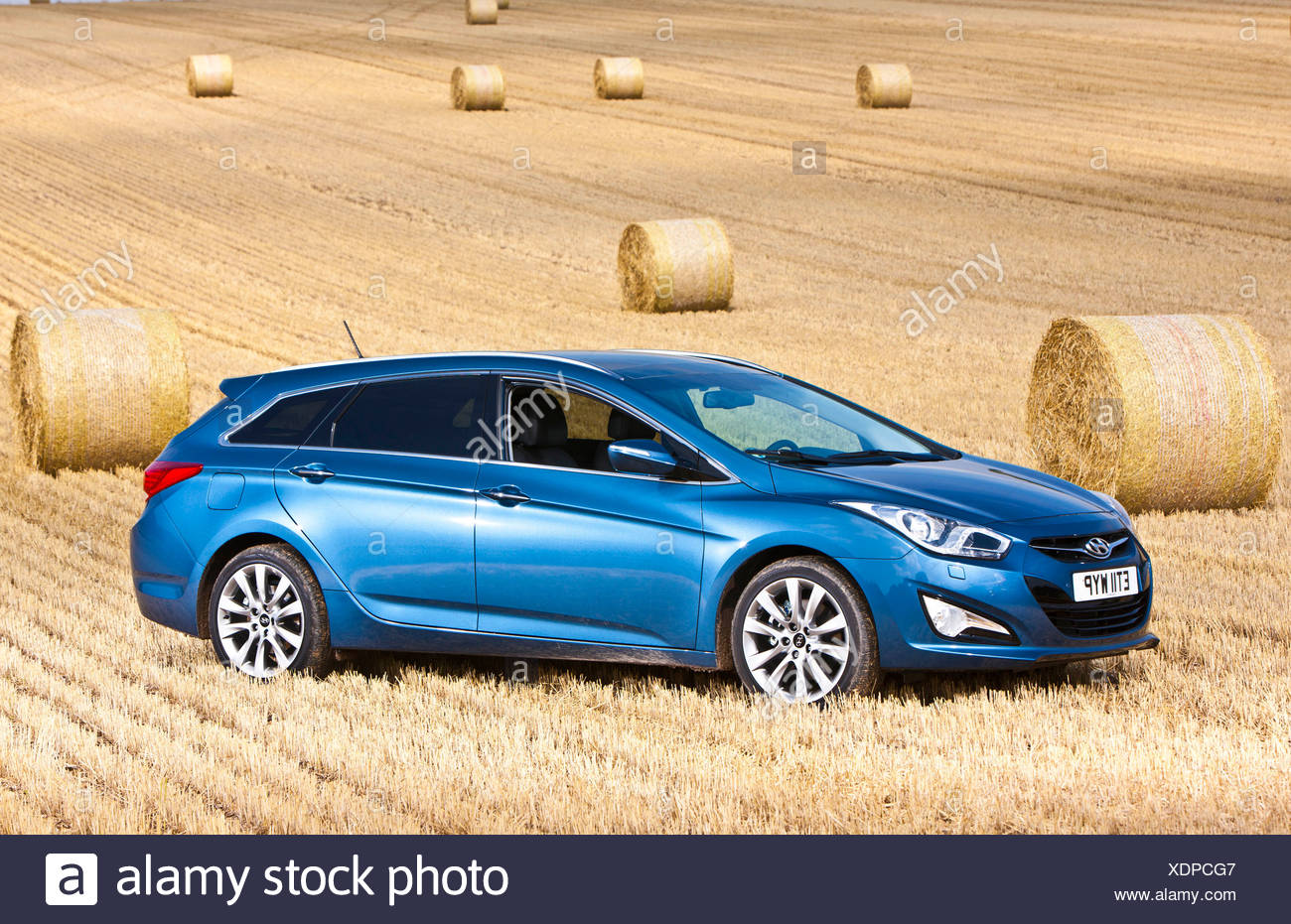 Hyundai i40, large family car, in a hayfield, Southampton, - Stock Image