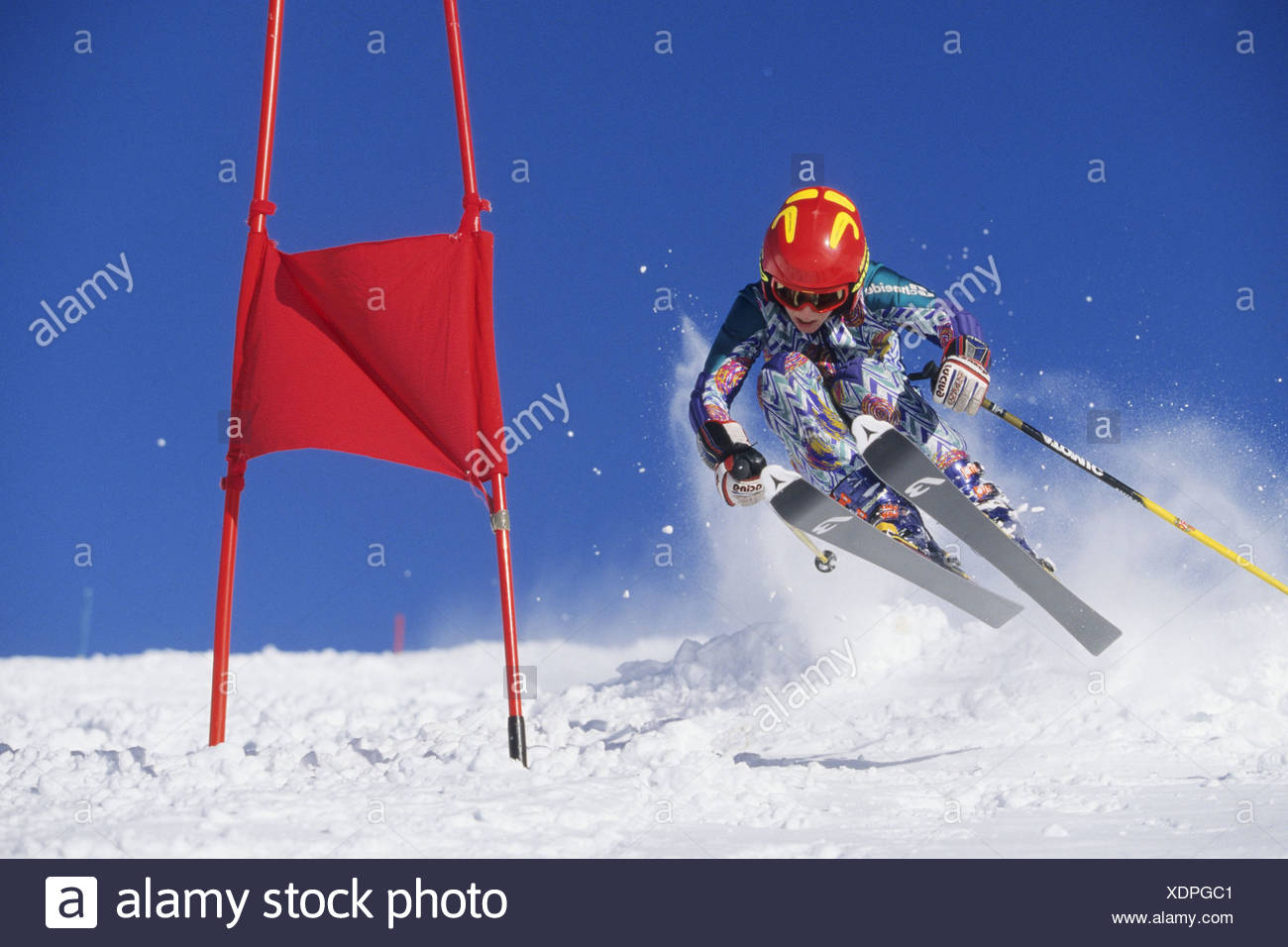 skier racing downhill, Austria, Alps - Stock Image