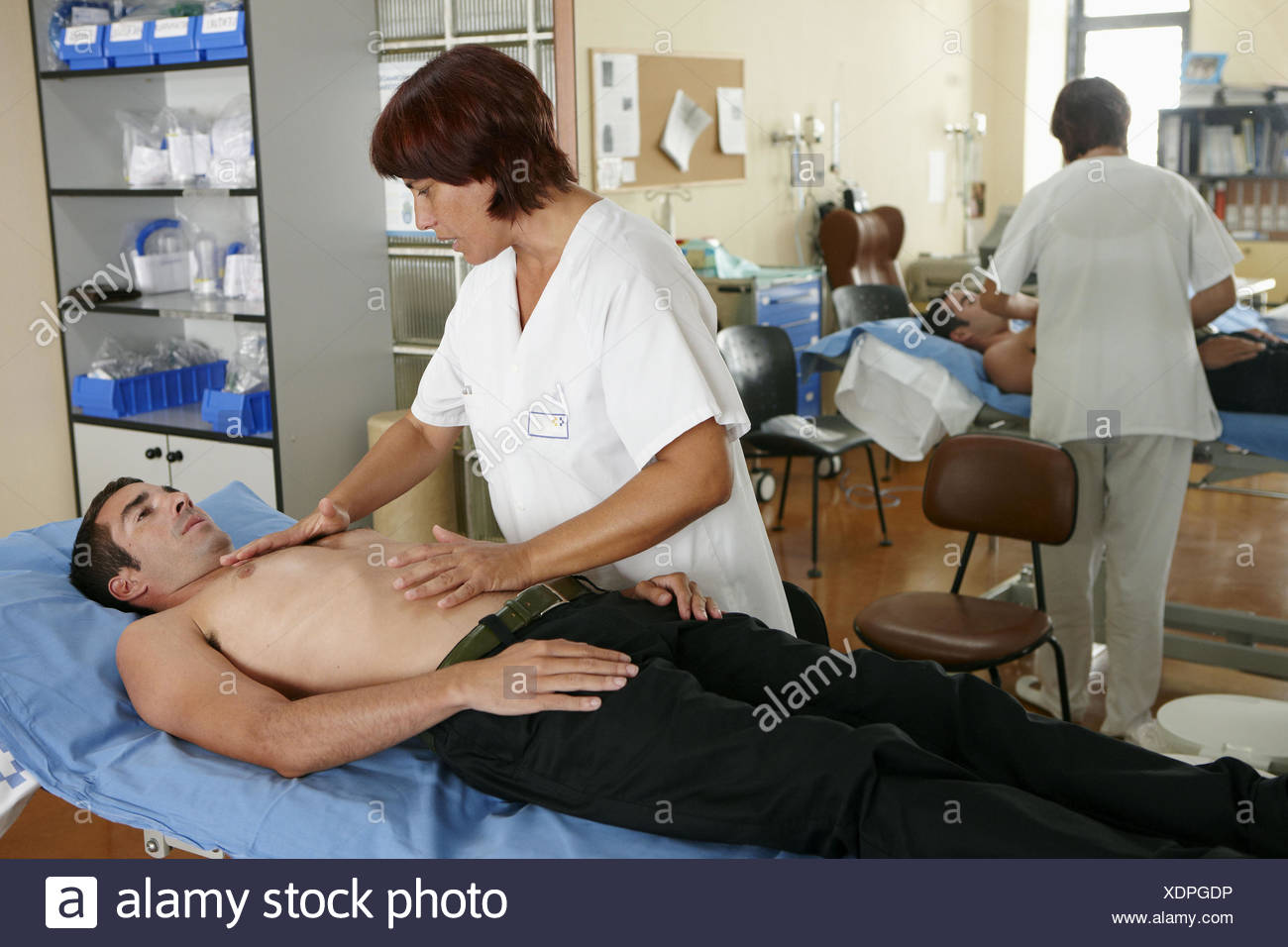 Occupational therapy, physiotherapy, mechanical ventilation on diaphragm, thoracic vibration maneuvers. Hospital Universitario - Stock Image