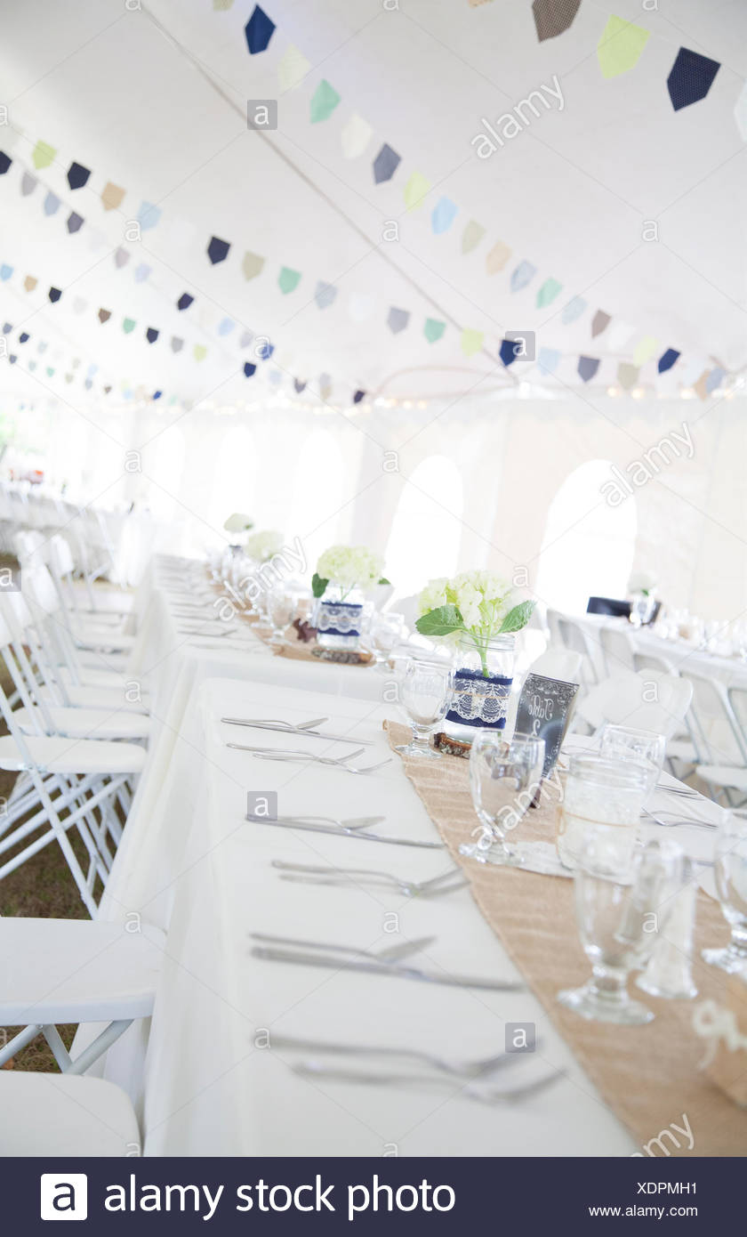 Tables And Tent Country Style Wedding Reception Stock Photo