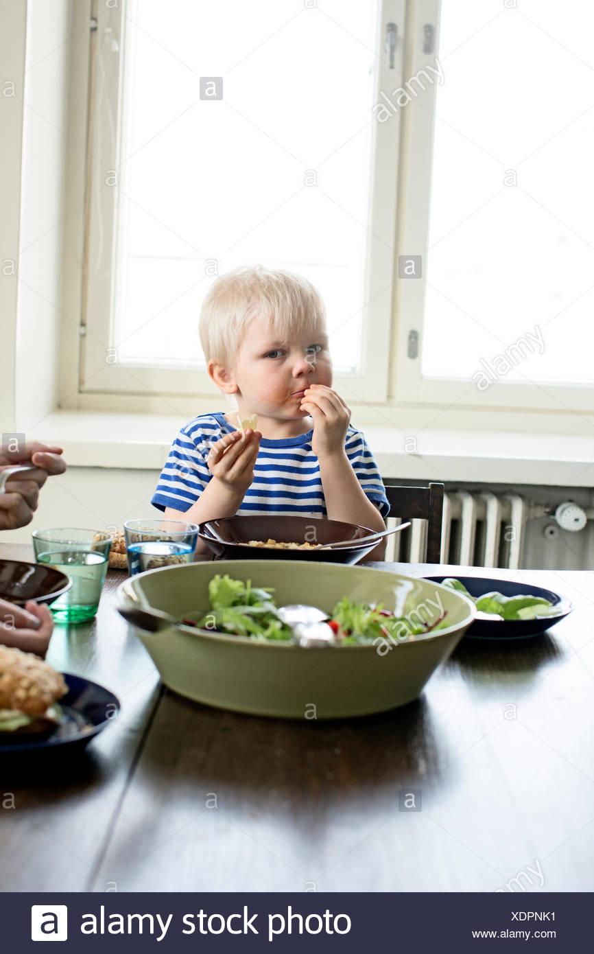 Finland, Helsinki, Kallio, Boy eating lunch - Stock Image