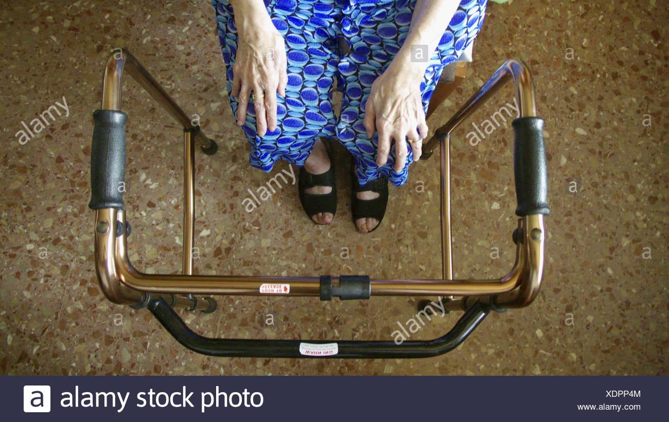 old person siting with walker - Stock Image