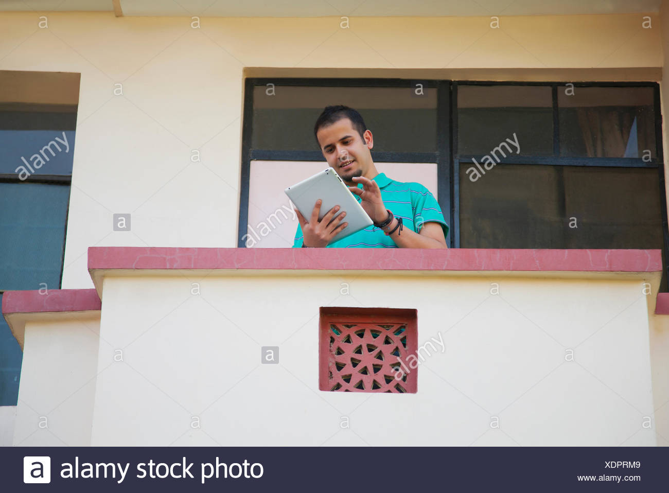 Portrait of graduate student with diploma - Stock Image