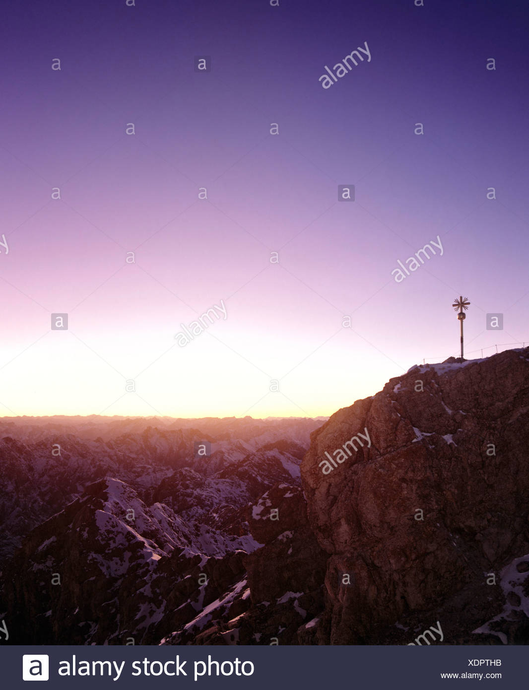 Summit cross at 2962 m or 9718 ft on the Zugspitze, Germany's highest mountain, at dawn, Wetterstein Range, Werdenfels Region,  - Stock Image