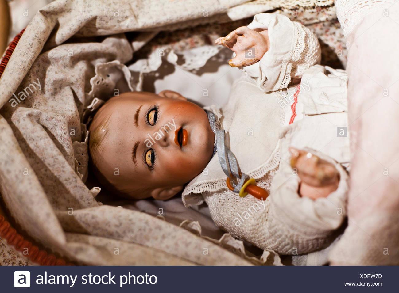 Old porcelain doll - Stock Image